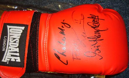 Boxing glove signed by Charlie Magri, Sir Henry Cooper & Frank Bruno