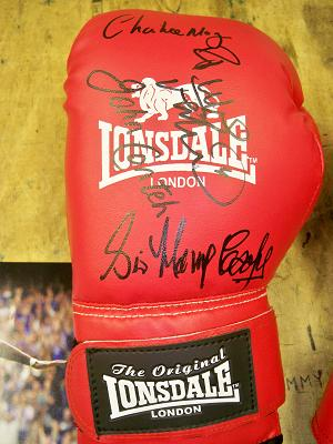 Boxing glove signed by Charlie Magri, Sir Henry Cooper, Frank Bruno, & John Conteh