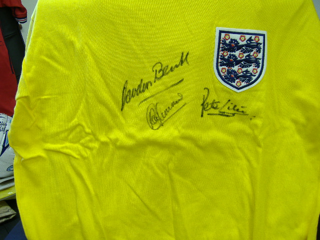 Yellow England goalkeepers jersey signed by Banks, Shilton & Clemence