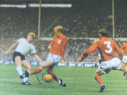 Bobby Moore in 1966 action signed magazine picture