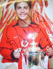 Christiano Ronaldo poses with the FA Cup