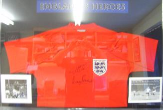 England Heroes Red replica shirt signed by Martin Peters and Geoff Hurst